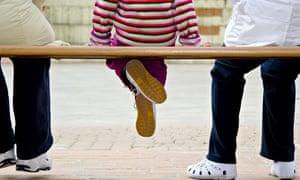 Child sat on bench
