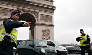 Police on the streets of Paris, on the lookout for cars with number plates that end in even numbers