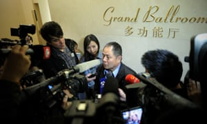 A relative of passengers from missing Malaysia Airlines flight MH370 speaks to the media at a hotel in Beijing.