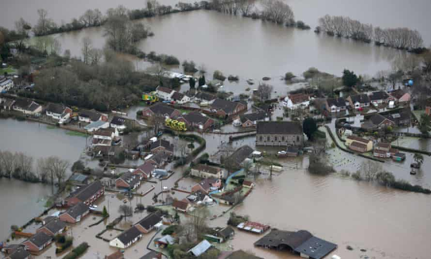 Flooded propeties are seen as water surrounds the village of Moorland on the Somerset Levels near Bridgwater on February 10, 2014 in Somerset, England.