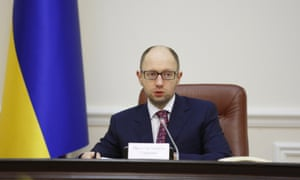 The parliament-approved Ukrainian prime minister, Arseniy Yatsenyuk chairs a government meeting on 16 March, 2014 in Kiev,