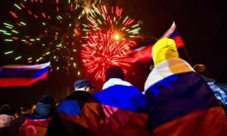 People in Russian flags celebrate Crimea referendum results