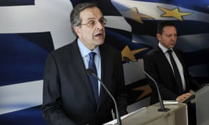 Greek Prime minister Antonis Samaras (L) and Finance minister Yiannis Stournaras address the press at the Greek Finance ministry in Athens on March 18, 2014, after Greece's international creditors have reached agreement with Athens on efforts to stabilise the crisis-hit country's public finances, clearing the way for its next debt aid payment.