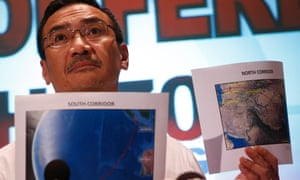 Malaysia's acting transport minister Hishamuddin Hussein shows maps of the southern and northern flight corridors being searched for the missing plane.