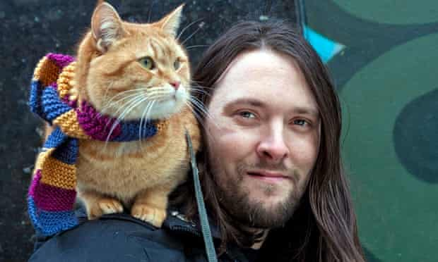 James Bowen, author, with Bob the street cat