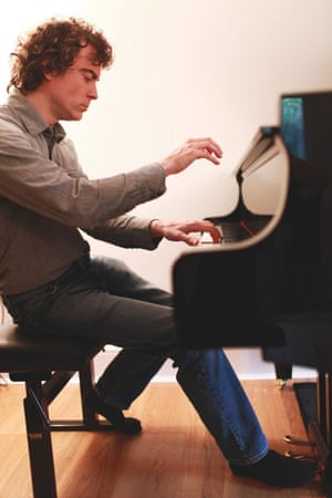Paul Lewis plays for a portrait at his Yamaha piano in his new home studio in Bovingdon, England, March 2014.