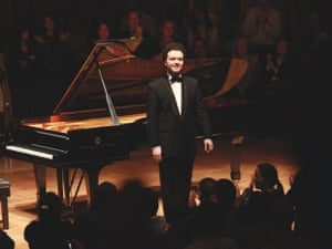 Russian pianist and former child prodigy Evgeny Kissin takes a bow after a solo recital of works by Chopin and Beethoven at the Barbican on 2 March, 2012 in London.