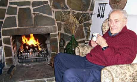Geoff Amatt in front of his fire