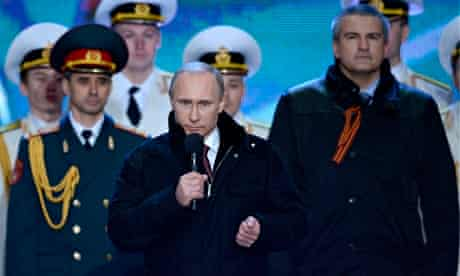 Vladimir Putin speaks at a rally