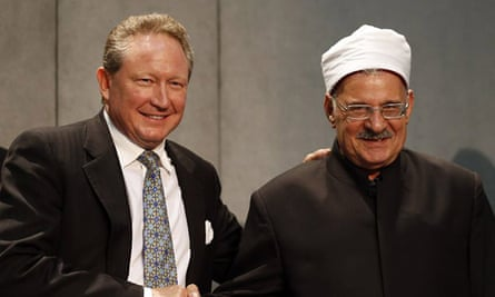 Andrew Forrest shakes hands with Mahmoud Azab