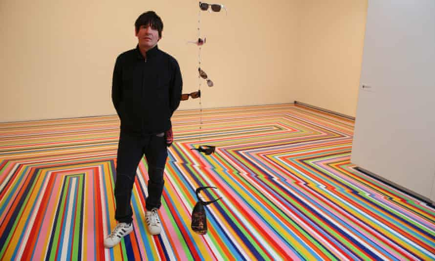 Jim Lambie with his work Screamadelica at the Museum of Contemporary Art, Sydney.