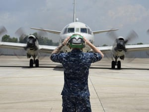 A US navy P-3C Orion taxis for takeoff from Kuala Lumpur to search for Malaysian Airlines flight MH370