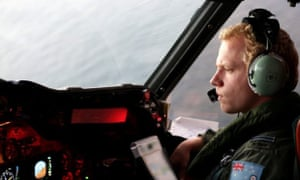 A crew member on board RAAF AP3C Orion aircraft during a search operation for the missing Malaysia Airlines plane in the southern Indian Ocean.  The Australian Marine Safety Authority is coordinating the search in a vast area west of Perth.