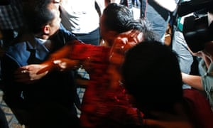 A Chinese family member of a passenger onboard the missing Malaysia Airlines Flight MH370 screams as she taken out of the media conference area at a hotel in Kuala Lumpur International Airport.