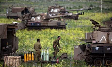 Soldiers from the Israeli amid tanks and artillery in the Golan Heights