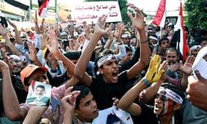 Yemenis shout slogans