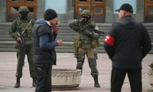 Heavily-armed troops displaying no identifying insignia and local pro-Russian militants stand guard outside a local government building in Simferopol, Ukraine on 2 March, 2014.