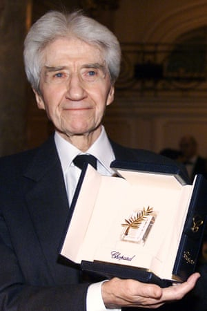 2002: Alain Resnais with the Cannes film festival trophy received as a tribute to his works.