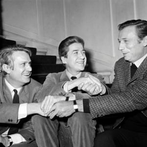 """1967: French film director Alain Resnais (C) speaks with french actor Yves Montand (R) and writer Jorge Semprun (L) after receiving the Louis Delluc award for his movie """"La guerre est finie""""in Paris."""