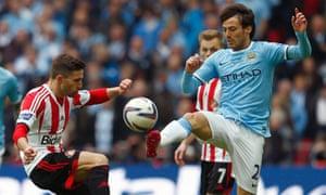 Sunderland goalscorer Fabio Borini challenges Man City's David Silva