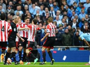 Fabio Borini celebrates opening the scoring for  Sunderland while Fernandinho looks forlorn.