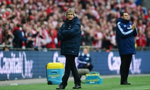 Manuel Pellegrini and Gus Poyet cut contrasting figures on the Wembley touchline.