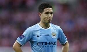 Samir Nasri is frustrated as Man City can't find a way through.