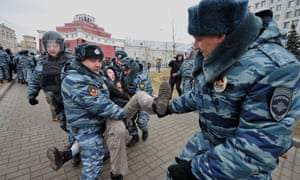 Russian police detain a protester during an unsanctioned anti-war rally close to the the ministry of defense on 2 March, 2014 in Moscow, Russia.