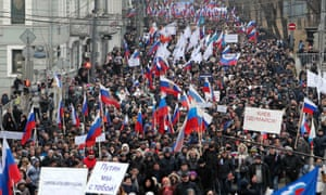 People march during a procession in central Moscow, 2 March, 2014. People gathered on Sunday to support the people of Crimea and Ukraine, including Russian speakers, and to protest against the policies conducted by Ukraine's new authorities recently elected in Kiev, according to organisers.