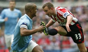 Lee Cattermole clears away under pressure from Vincent Kompany.