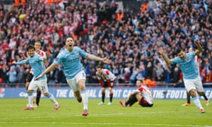 Samir Nasri celebrates after scoring the second goal for Manchester City in the League Cup final against Sunderland.