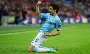 Jesús Navas of Manchester City celebrates after scoring his team's third goal.