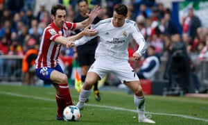 Real Madrid's Cristiano Ronaldo (R) holds off Atletico Madrid's Juanfran in a physical Madrid derby.