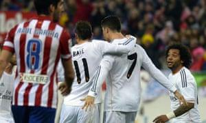 Cristiano Ronaldo and Gareth Bale share an expensive embrace.