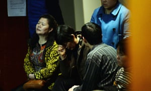 Chinese relatives of passengers from the missing Malaysia Airlines flight MH370 react as they wait for news at the Metro Park Lido Hotel in Beijing.