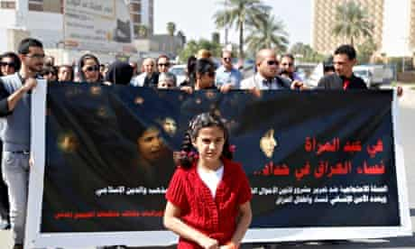 """A demonstration against the draft of the """"Al-Jafaari"""" personal status law. The sign reads, """"Women ar"""