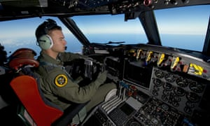 Royal Australian Air Force pilot, Flight Lieutenant Russell Adams steering his AP-3C Orion over the Southern Indian Ocean during the search for missing Malaysia Airlines flight MH370.