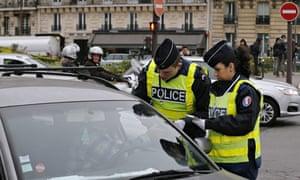 Paris car ban: police officers check a vehicle