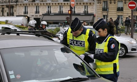 Paris car ban: police officers check a vehicle