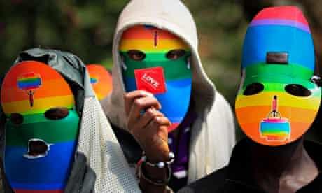 Masked Kenyans protest against Uganda's anti-gay bill at the Ugandan High Commission in Kenya