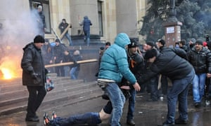 Pro-Russian protesters drag wounded man