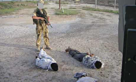 A photo shown at the al-Sweady inquiry, showing Iraqis being guarded by a British soldier.