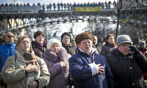 Women singing the Ukrainian national anthem in Independence Square last month