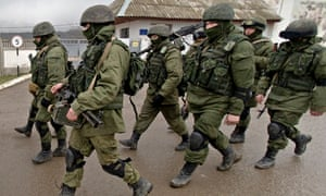 Pro-Russian soldiers march outside a Ukrainian military base in Crime