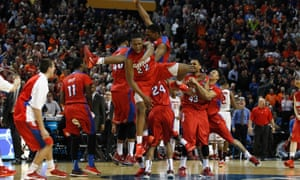 Dayton Flyers celebrate after beating Ohio State Buckeyes in the men's college basketball second round of the 2014 NCAA Tournament at First Niagara Center.