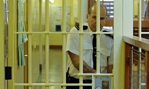 A prison officer at Belmarsh locks a door