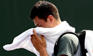 Bernard Tomic leaves the court in Miami