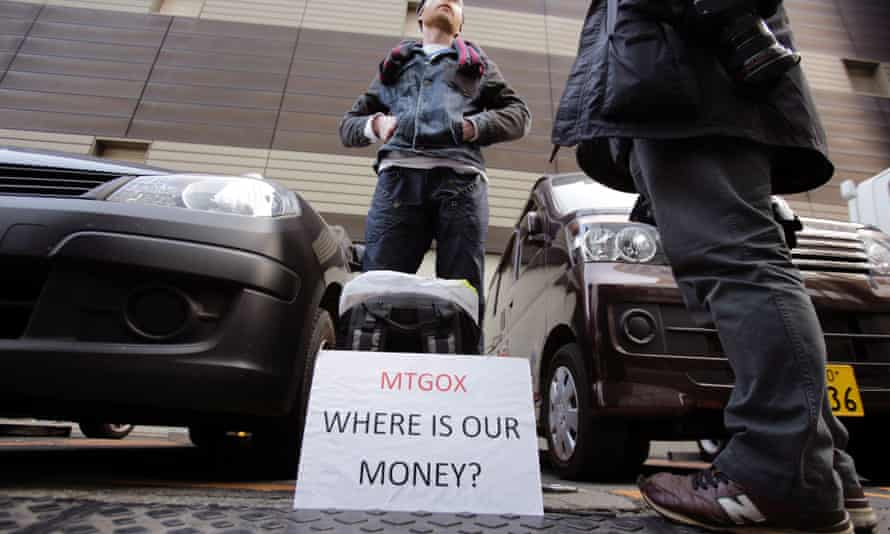 Bitcoin trader Kolin Burges stands in protest outside an office building housing Mt. Gox in Tokyo.