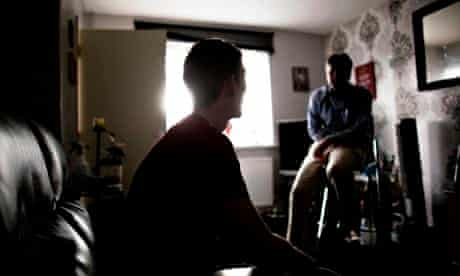 a mental health worker visiting a patient at home