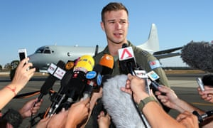 Royal Australian Air Force pilot Captain Russell Adams addresses the media after returning from the search mission.